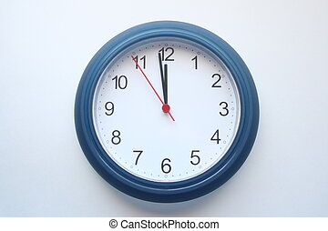 12 o clock - clock showing one minute to 12
