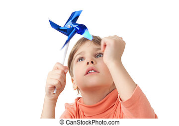 pretty little girl plays with toy propeller stick isolated...