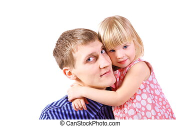 little girl wearing dress is embracing her father father...