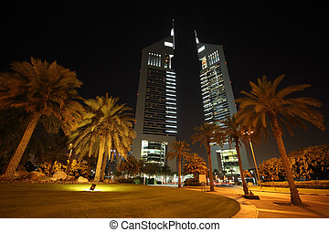 DUBAI - APRIL 18: Emirates Towers and area with palms and...