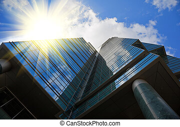mirror office building in high tech style, blue sky with...