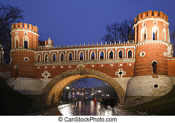 Nightlighting bridge of State historical and architectural museum reserve Tsaritsyno, Russia. It was build in 1776.