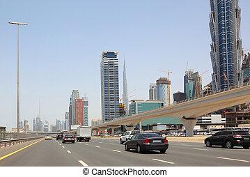 DUBAI - APRIL 18: general view on trunk road, skyscrapers and Burj Dubai, 18 april 2010 in Dubai, UAE