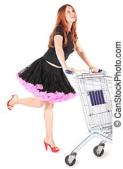 beautiful woman wearing dress is moving shoping basket and...