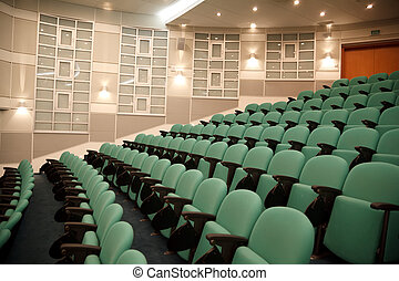 Interior of hall for conferences. Rows of chairs for...