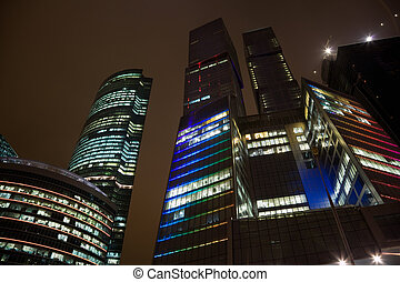 top floors of modern office building at night, skyscraper in moscow, foreshortening from below