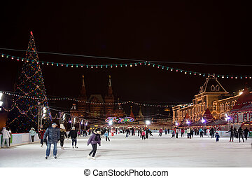 skating-rink on red square in moscow at night. GUM trading...