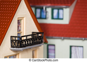toy plastic house with an extension and balcony