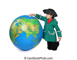 boy in historical dress sits near big inflatable globe...