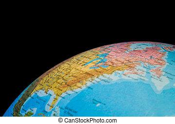 Fragment of globe of world isolated on black background,...