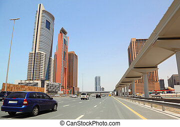 DUBAI - APRIL 18: trunk road and skyscrapers on April 18, 2010 in Dubai, UAE. Dubai is the most fast-growing city on the Earth.