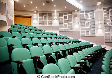 empty conference hall, rows of a chairs, eight numbers in...