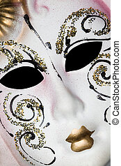 White Venetian mask with patterns, Lying on diagonal