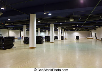 Large, empty warehouse. Ventilation and lighting equipment...