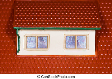 attic on roof of toy plastic house,two windows