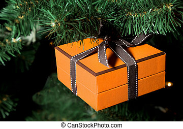 celebratory gift in yellow boxes hanging on Christmas artificial fur-tree