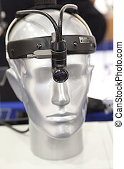 Medical headlight on the head of the dummy. Medical Equipment. Vertical format.