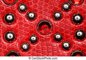 red leather texture with metal rivets and precious stones