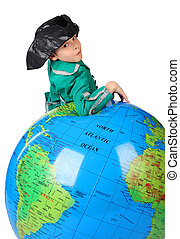 boy in historical dress leans on inflatable globe isolated...