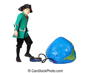 little boy in historical dress pumping inflatable globe...