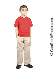 little boy in red shirt hands in pockets standing on white background