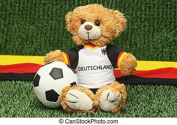 Talisman - Teddy bear with football shirt on lawn background