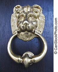 golden lionhead doorknocker of traditional oriental design