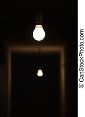 light in the dark - Bare light bulbs in dark underground...