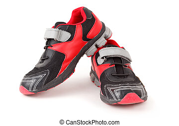 Pair of sports shoes, black and red colors on white background. Isolated.