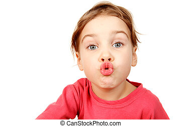 Portrait of girl in pink shirt on white background. She looks into camera, lips depicting kiss. Isolation.
