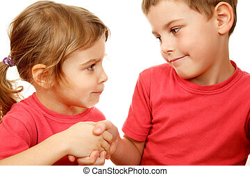 Brother and sister in pink shirts with smile shake hands....