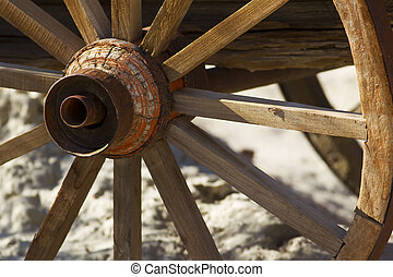 Wagon Wheel - A weathered wagon wheel in a desert...