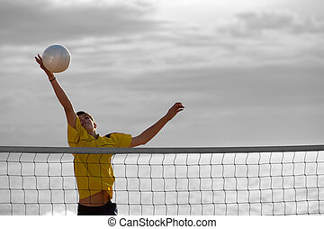 Beach volley - Teenager in action during a match of beach...