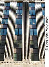 Strong vertical lines of an office building in Washington, DC, USA.