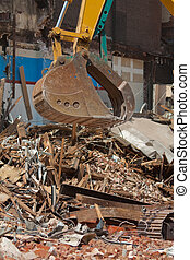 Demolition Equipment Claw, Pile of Debris at Work Site