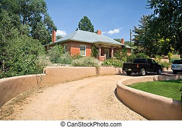 Brick Home Santa Fe, New Mexico Gravel Drive Adobe Wall