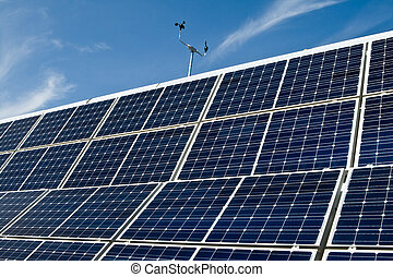 PV Solar Panel Array Against Blue Sky Anemometer