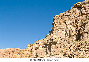 Crumbling Sandstone Cliff Side Near Abiquiu, New Mexico -...