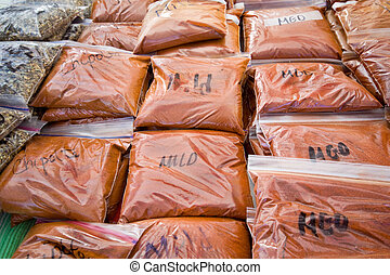 Bags of Ground Pepper marked Mild, Medium, Chipotle Found in...
