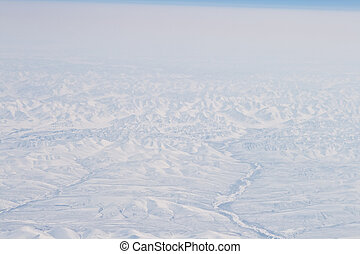 Snow Covered Verkhoyansk Mountains Aerial Northern Siberia,...