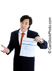 Asian Man in a suit holding a past due medical bill with a...