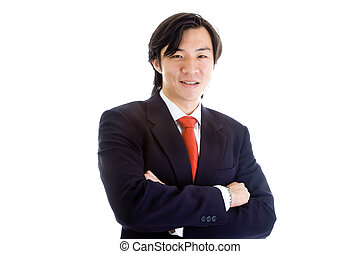 Confident Asian businessman in a suit with arms crossed...