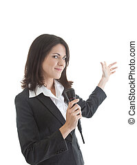 Smiling Caucasian woman holding wireless microphone and gesturing behind herself.   Isolated on white background.