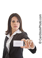 Happy Caucasian woman in business suit smiling and holding out business card.  Isolated on white.