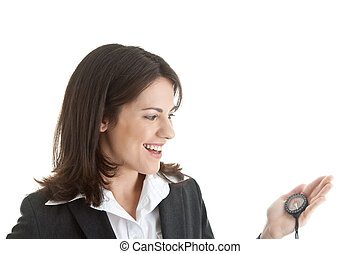 Happy Caucasian woman in a suit looking at a compass.  Isolated on white background.