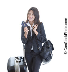 Smiling white woman traveling.  She's holding a U.S. Passport and has a shoulder bag and suitcase.