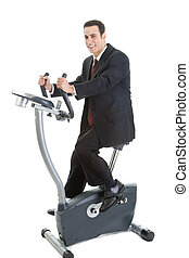 Happy Caucasian Man Suit on Exercise Bike Isolated White...