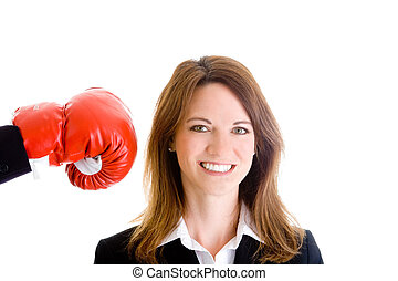Happy woman unaware she is about to be punched with a boxing glove.  Isolated on white background.