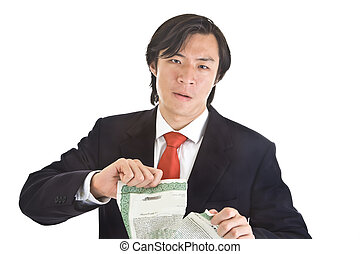 Unhappy Asian man ripping up a stock certificate.  Worthless investment theme.  Isolated White Background.
