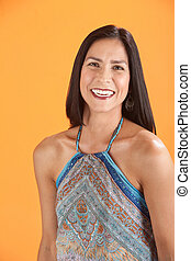Happy Woman - Latina woman with a big smile on an orange...